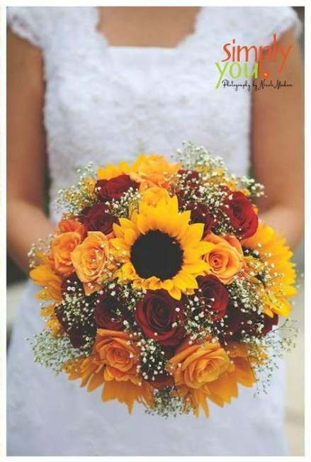 bouquet sposa girasoli e rose rosse
