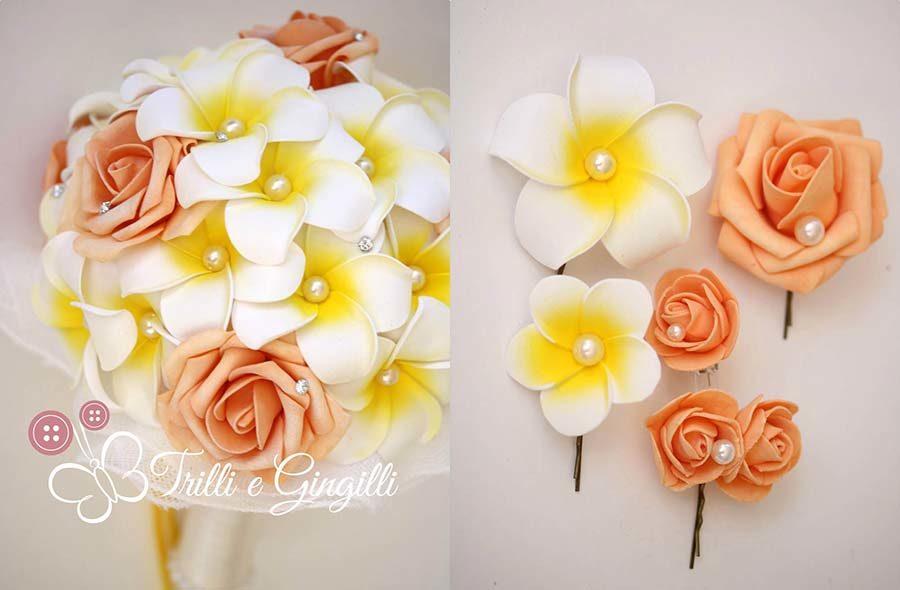 bouquet di frangipani e rose arancioni