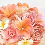 Bouquet sposa tema mare frangipani rosa pesca