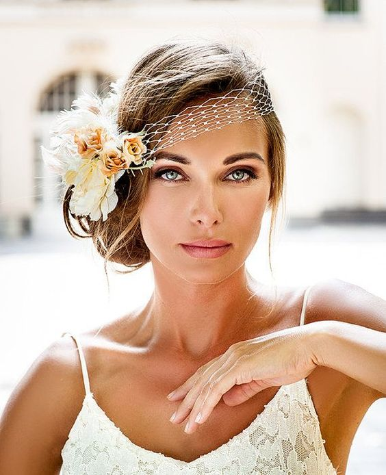 acconciatura sposa vintage fiori